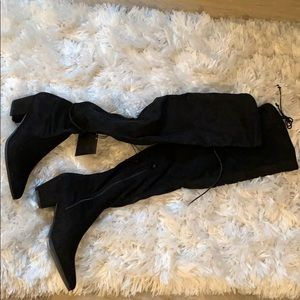 Black knee high heeled suede boots